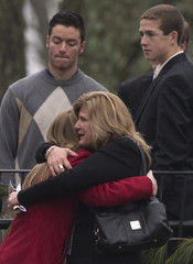 Mourners embrace outside a funeral home after attending services for Jack Pinto, one of 20 schoolchildren killed in the Sandy Hook Elementary School shootings, in Newtown, Connecticut