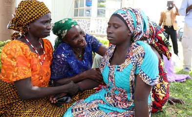 Newly released 82 Chibok school girls reunite with their families in Abuja