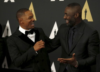 Actors Smith and Elba greet each other at the 7th Annual Academy of Motion Picture Arts and Sciences Governors Awards at The Ray Dolby Ballroom in Hollywood