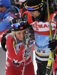Second placed Johaug of Norway reacts after she finshed the FIS cross-country World Cup women's 10 km classic mass start event in Rogla