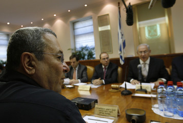 Israel's Defence Minister Barak sits across from Prime Minister Netanyahu during a cabinet meeting in Jerusalem