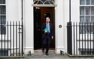 Britain's Chancellor of the Exchequer Philip Hammond  leaves 11 Downing Street on his way to present his Autumn Statement in the House of Commons, in London
