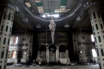 A burnt mosque by Yazidi people is seen in the town of Sinjar