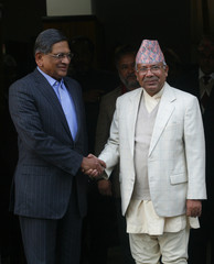 Nepal's Prime Minister Madhav Kumar Nepal shakes hands with Indian Minister for External Affairs S.M. Krishna in Kathmandu
