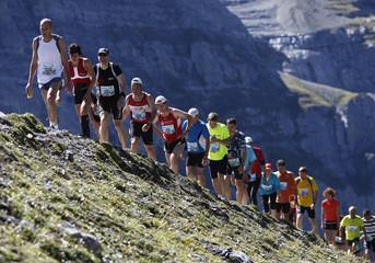 Athletes run up the moraine of the Eiger glacier during the Jungfrau-Marathon near Kleine Scheidegg