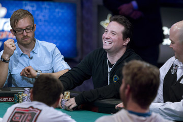 Bruno Politano of Brazil smiles after winning a hand during the World Series of Poker $10,000 buy-in No-limit Texas Hold 'em Main Event at the Rio Hotel and Casino in Las Vegas