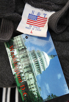 """The label of a Washington D.C. sweatshirt bears a U.S. flag but says Made in China""""at a souvenir stand in Washington"""