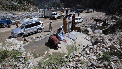 Residents offer mid-day prayers on the outskirts of of Gilgit