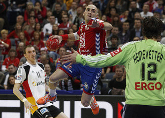 Nikcevic of Serbia attempts to score against Germany's goalkeeper Heinevetter during their Men's European Handball Championship main round match in Belgrade