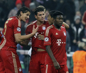 Munich players celebrate after their Champions League soccer match against Napoli in Munich