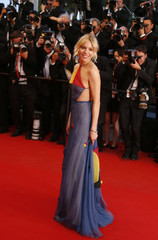 """Jury member actress Sienna Miller poses on the red carpet as she arrives for the screening of the film """"Maryland"""" at the 68th Cannes Film Festival in Cannes"""
