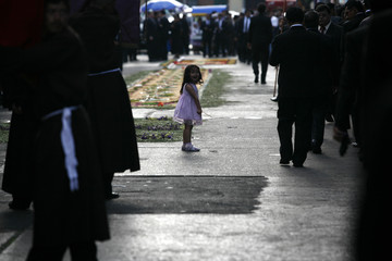 A girl takes part in a Holy Week procession in Guatemala City