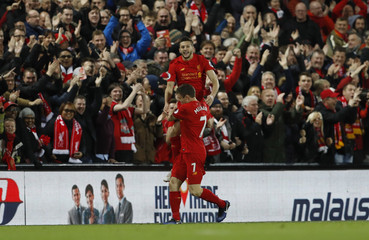 Liverpool's Adam Lallana celebrates scoring their first goal with James Milner