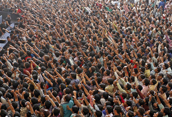 Fans use their mobile phones to capture a glimpse of Bollywood actor Khan at a multiplex in Ahmedabad
