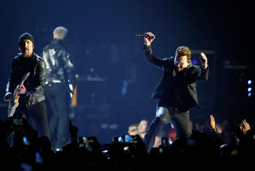 Guitarist The Edge and Bono of U2 perform during the iHeartRadio Music Festival at The T-Mobile Arena in Las Vegas