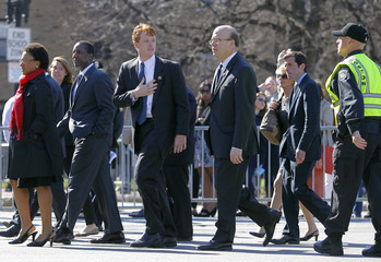 Congressman Joseph P. Kennedy III (D, MA) gestures to a police officer as he arrives at the Cathedral of the Holy Cross for an interfaith service for the victims of the Boston Marathon bombings in Boston