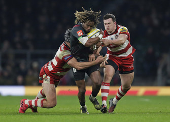 Marland Yarde of Harlequins tackled by Ben Morgan (L) and Matt Scott of Gloucester Rugby