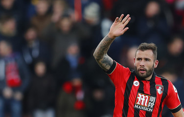Bournemouth's Steve Cook celebrates scoring their third