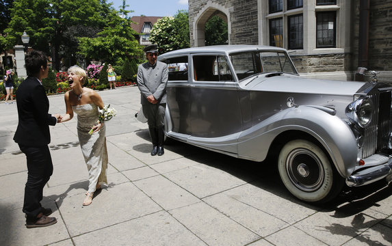 """Neales and her partner Tweddle arrive for """"The Celebration of Love"""" at Casa Loma in Toronto"""