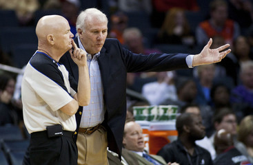 Spurs head coach Popovich questions a call against the Bobcats during their NBA basketball game in Charlotte