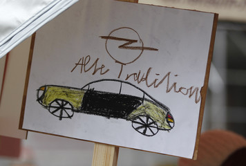 A drawing shows an Opel car at a solidarity festival for carmaker Opel in Bochum