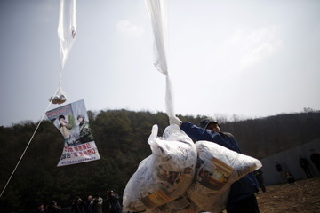 Park Sang-Hak holds a balloon containing leaflets denouncing North Korean leader Kim Jong Un in Paju