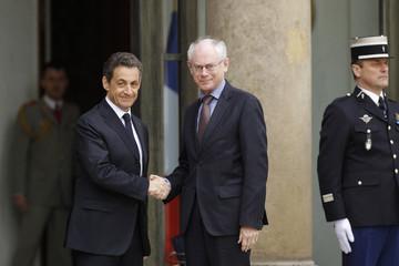 France's President Sarkozy greets European Council President Herman Van Rompuy at the Elysee Palace ahead of international talks on Libya in Paris