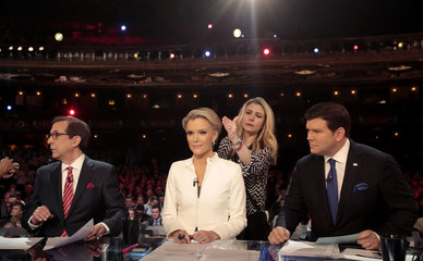 Fox News Channel anchors Wallace, Kelly and Baier prepare to moderate at the U.S. Republican presidential candidates debate in Detroit