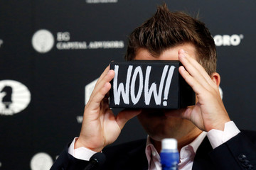 World chess champion Magnus Carlsen looks through a virtual reality viewer during a news conference ahead of the 2016 World Chess Championship in New York