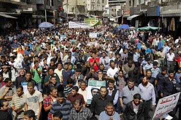 Supporters of Jordan's opposition parties shout slogans during a demonstration after Friday prayers in Amman