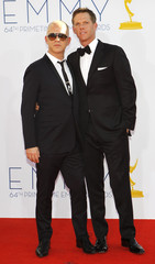 Ryan Murphy and David Miller arrive at the 64th Primetime Emmy Awards in Los Angeles
