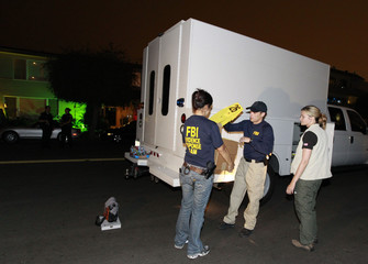 Federal Agents arrive at the apartment building of accused Boston crime boss James Whitey Bulger in Santa Monica