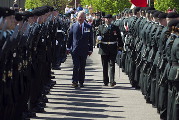 Britain's Prince Charles inspects the honour guard during the welcoming ceremony at CFB Gagetown