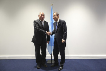 Xie Zhenhua, Special Representative for Climate Change of China, and United Nations Secretary-General Ban Ki-moon pose during the World Climate Change Conference 2015 at Le Bourget