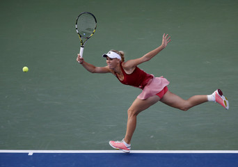 Wozniacki of Denmark hits a return to Williams of the U.S. during their women's singles finals match at the 2014 U.S. Open tennis tournament in New York