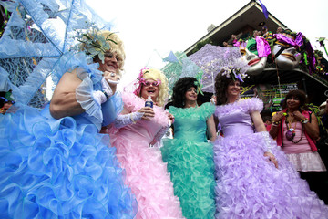 Revelers pose for pictures in the French Quarter on Mardi Gras Day in New Orleans