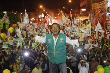Peru's pesidential candidate and former president Toledo waves during a campaign rally at the port of Callao in Lima