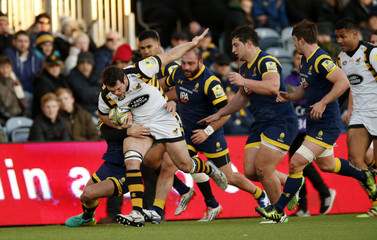 Wasps' Alex Rieder in action with Worcester Warriors' Jonny Arr