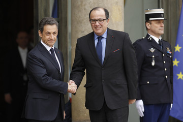 France's President Sarkozy greets Morocco's Foreign Minister Taib Fassi-Fihri at the Elysee Palace ahead of international talks on Libya in Paris
