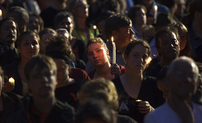 People attend a candlelight vigil for federal NDP leader Jack Layton in Vancouver