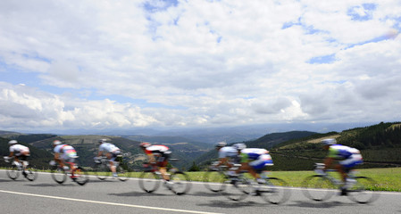 "A pack of riders cycle during the 13th stage of the Tour of Spain ""La Vuelta"" cycling race between Sarria and Ponferrada"