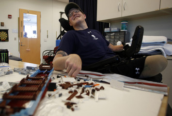 Sgt. Matt Krumwiede of the U.S. Army assembles a Lego set during occupational therapy at the Center for the Intrepid at Brooke Army Medical Center in San Antonio