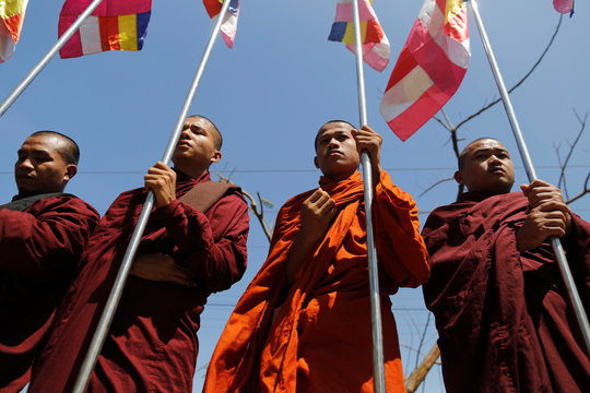 Buddhist monks protest while Malaysian NGO's aid ship carrying food and emergency supplies for Rohingya Muslims arrives at the port in Yangon