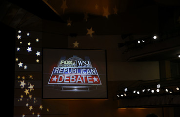 A logo for the Fox Business Network / Wall Street Journal is seen on a wall of the debate hall ahead of the debate held for the top 2016 U.S. Republican presidential candidates in Milwaukee