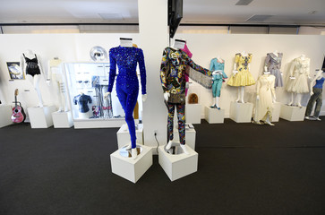 """Sapphire blue velvet catsuit and multicolor ensemble worn by Whitney Houston is pictured on display at Julien's Auctions for the upcoming """"Icons & Idols: Rock n Roll"""" auction in Beverly Hills"""