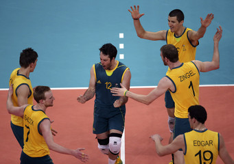 Australia's players celebrate winning a point during their men's Group A volleyball match against Britain at the London 2012 Olympic Games at Earls Court