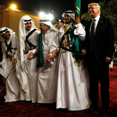 Saudi Arabia's King Salman welcomes Trump to dance with a sword during a welcome ceremony at Al Murabba Palace in Riyadh