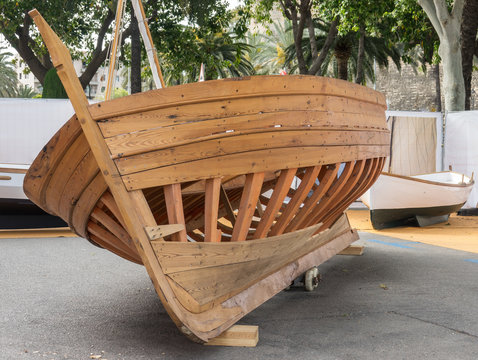Boat hull, skeleton of a wooden boat, wooden structure composed by Keel and frames of a half-built boat