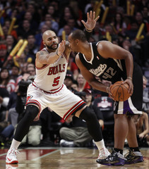 Chicago Bulls' Boozer guards Sacramento Kings' Hayes in the second half of their NBA basketball game in Chicago