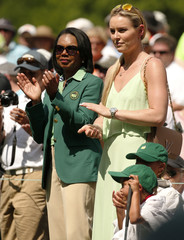 Augusta National member Rice stands with skier Vonn and U.S. golfer Woods' children Charlie and Sam during the par 3 event held ahead of the 2015 Masters at Augusta National Golf Course in Augusta
